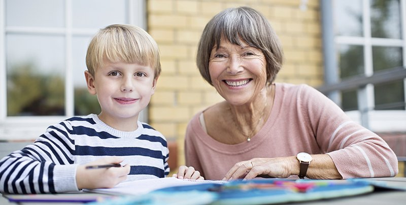Grandmother helping her grandson with his homework