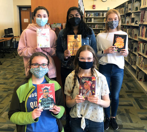 Photo of five students on Battle of the Books team